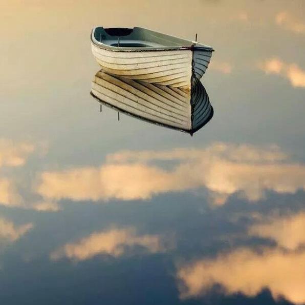 Boat on still water by Orjan Jalava