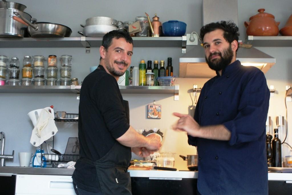 Michel Cardarilli (left) and Raph Regan preparing the food