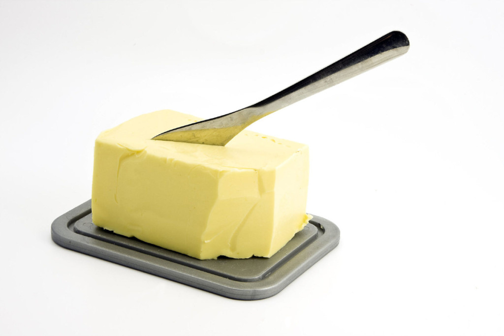 butter on a dish with knife. shutterstock photo.