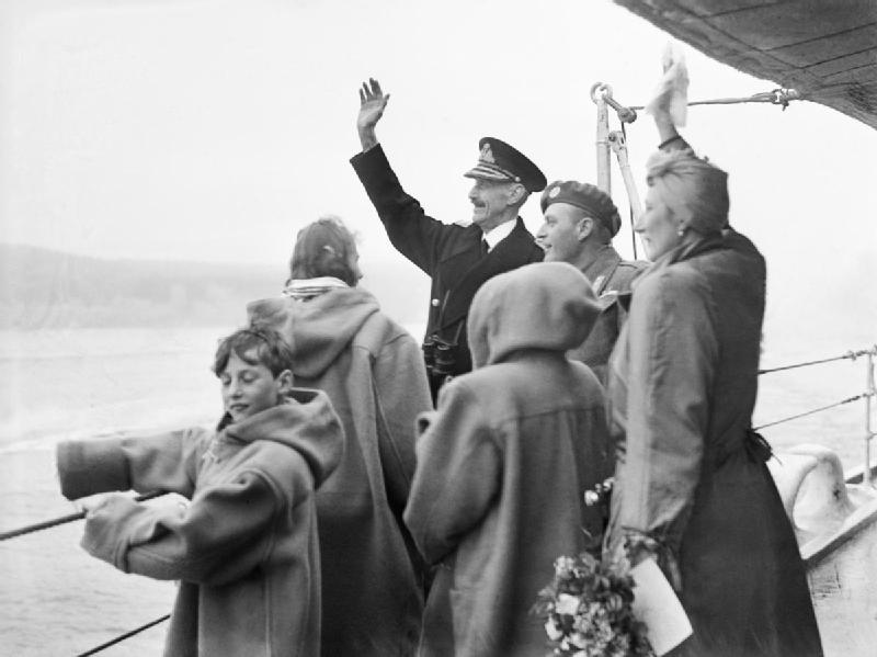 King Haakon and family waving to welcoming crowds from HMS Norfolk at the end of WWII