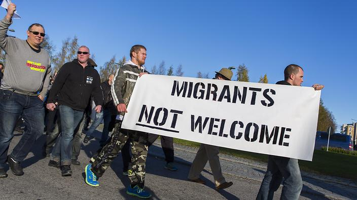 Anti-migration protesters attend a rally at the border town Tornio between Sweden and Finland, 03 October 2015.