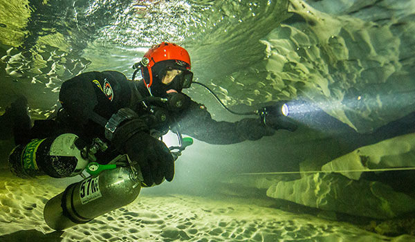 Dimitri: Since the caves most of the time are very narrov, the divers must hold their air cylinders by hand