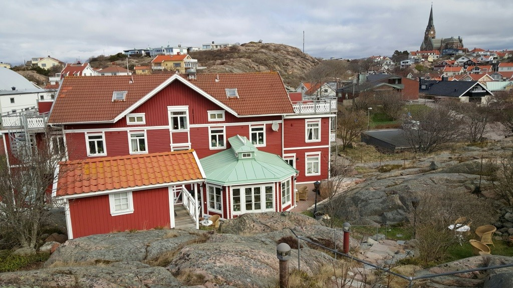 Strandflickorna hotel with Lysekil chirch in background. Photo: Helgard Mahrdt