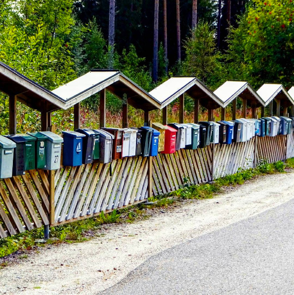 Postboixes in a row by Laila Haggelund
