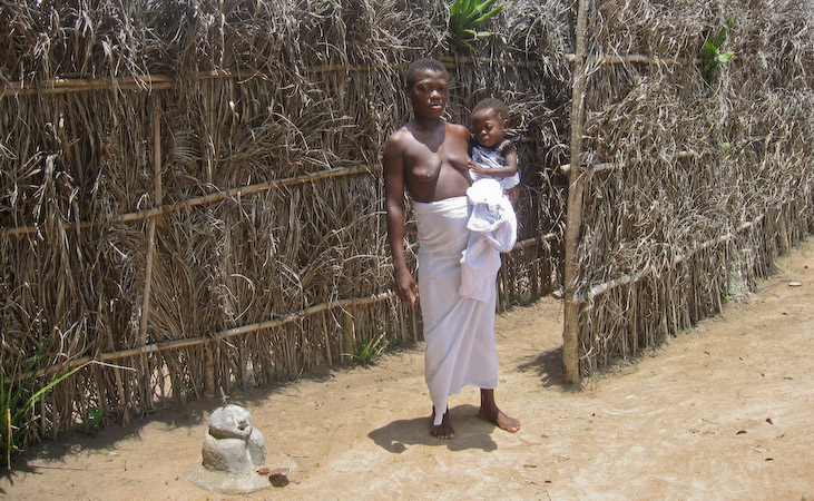 A Trokosi slave and her child in Ghana
